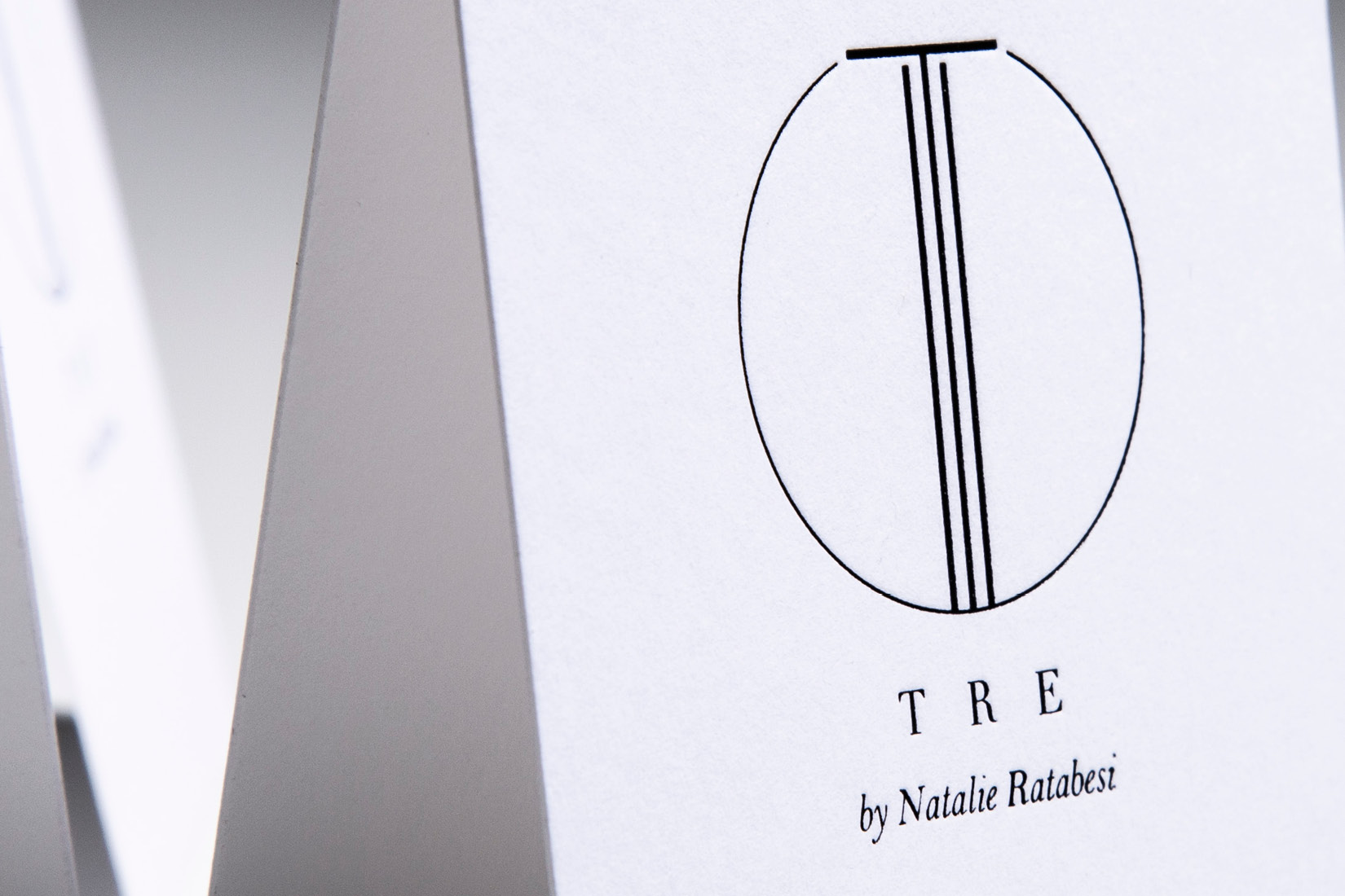 Print of the TRE brand logo by Natalie Ratabesi.