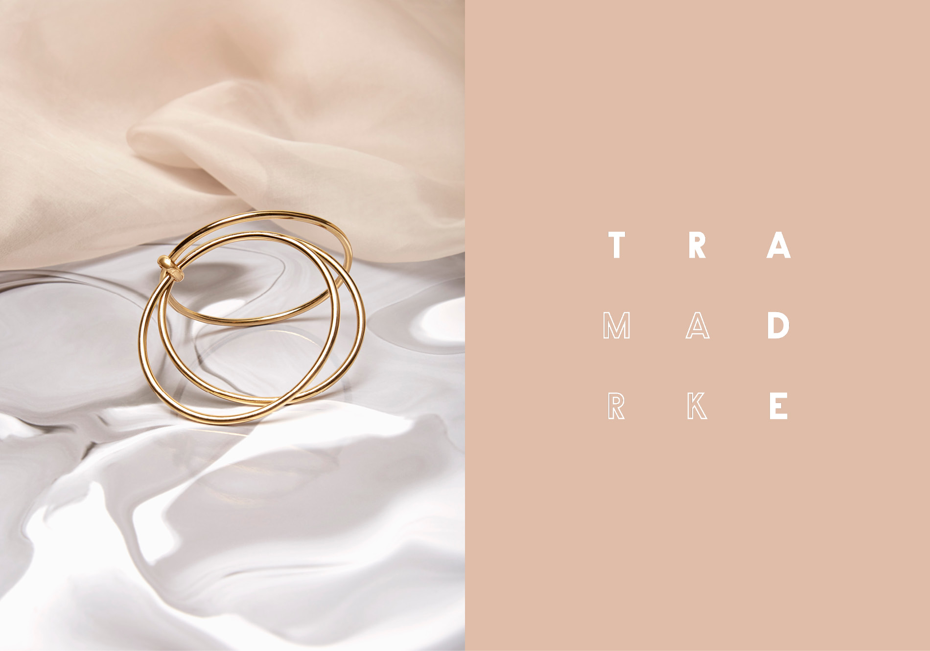 Trademark jewelry photographed on silk background by DTE Studio.