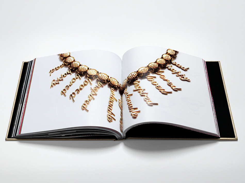 Double spread image of Fenton Fallon's jewelry in brand book designed by DTE