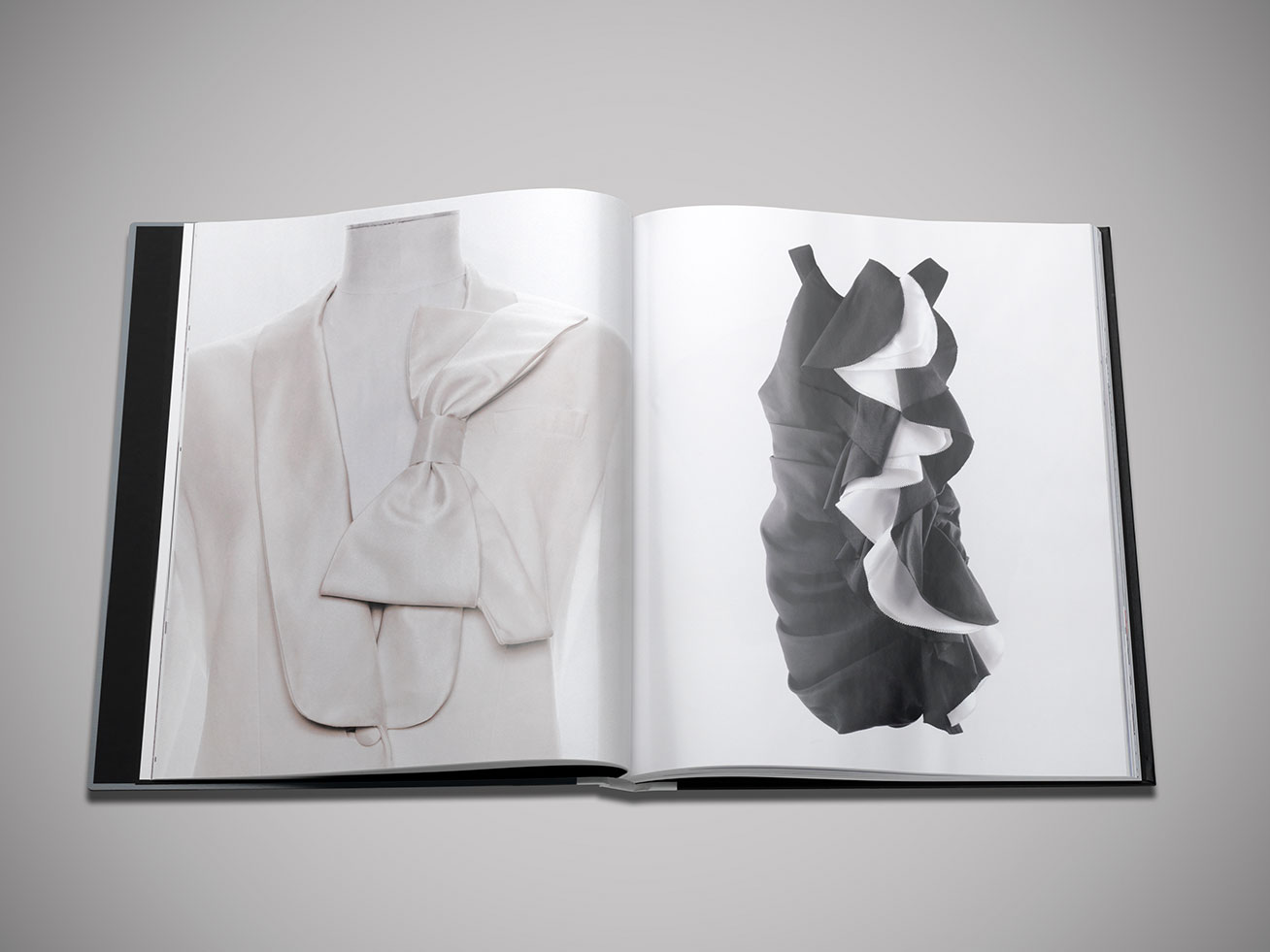 Two dressings show inside the brand book by Prabal Gurung.