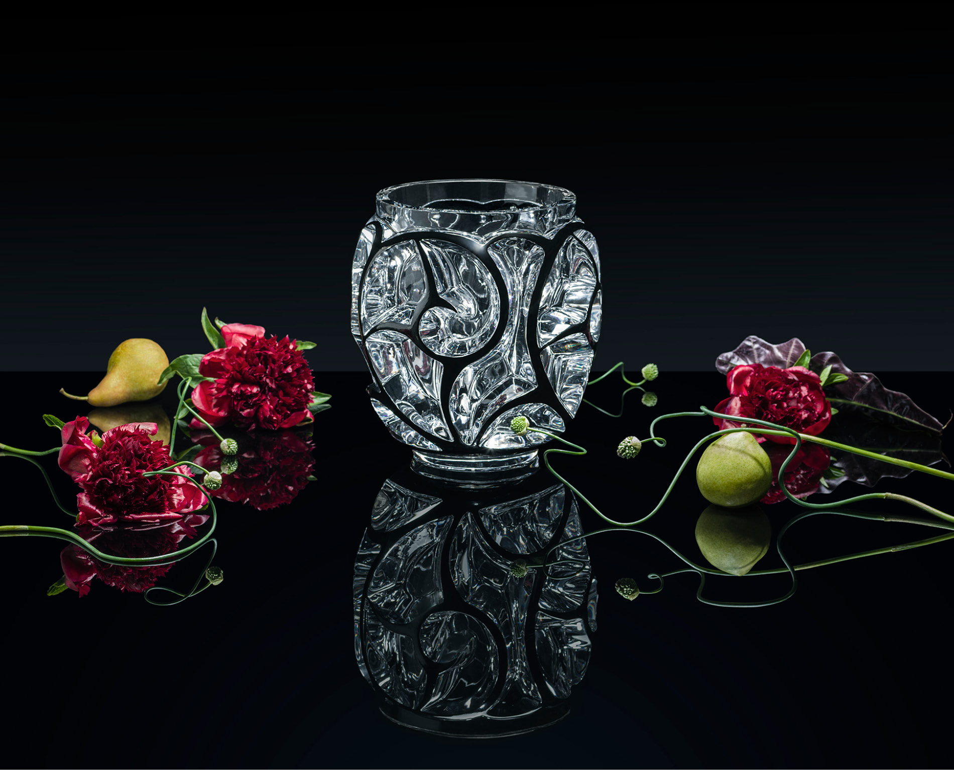 Elegant crystal vase by Lalique shot with fruits and flowers