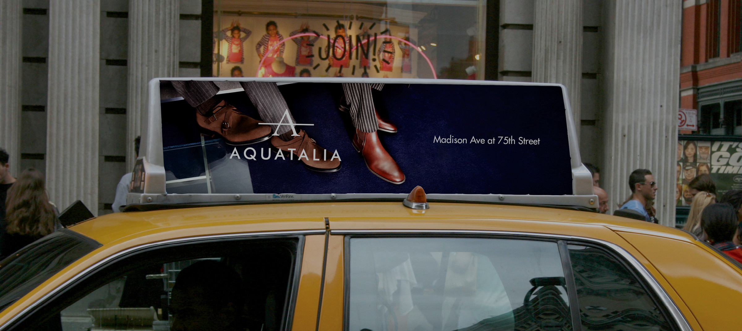 Aquatalia advertisement campaign shown on the top of a cab/.