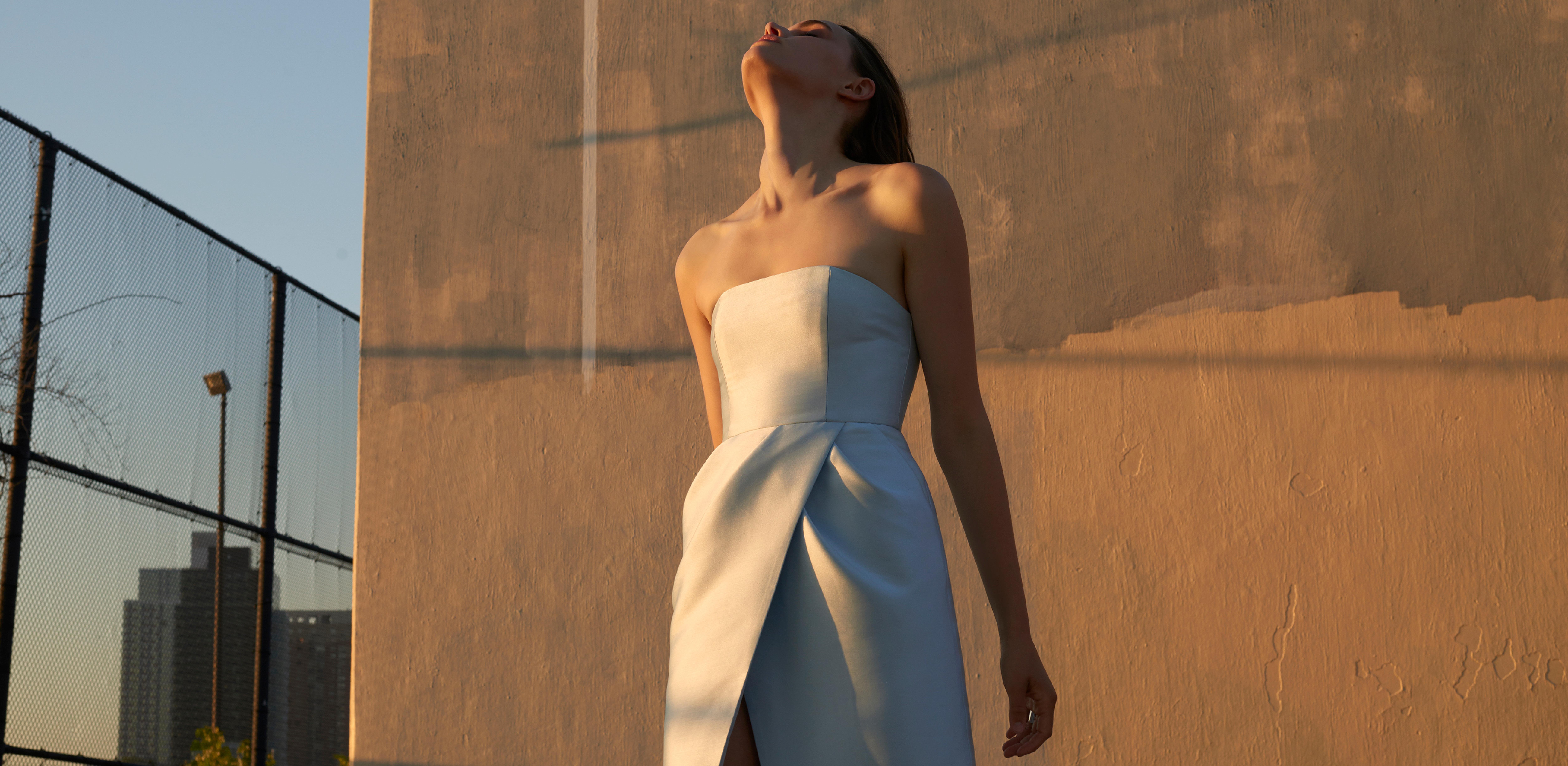 Model cast by DTE Studio wearing a silver dress.
